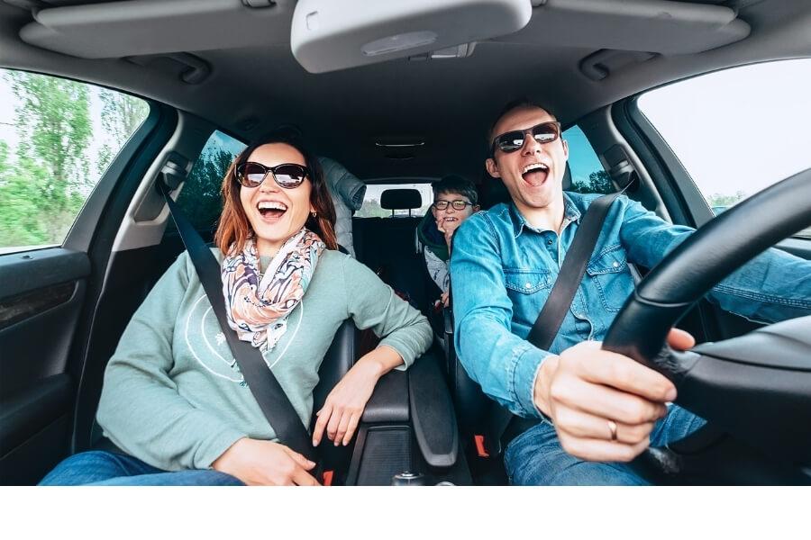 Family singing in car road trip
