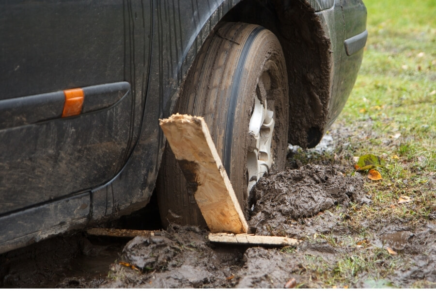 car stuck in mud trying to get traction