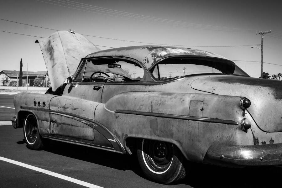 antique car broke down in parking lot